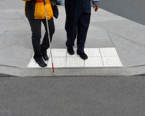 Blind and visually impaired people can use a straight cane like the one pictured above, or a folding cane, to walk with outside.