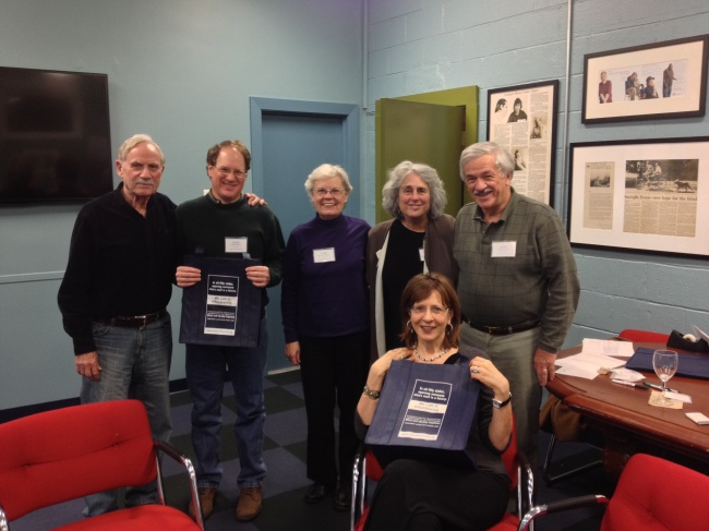 Six MABVI volunteers are gathered at the MABVI office in Brookline.
