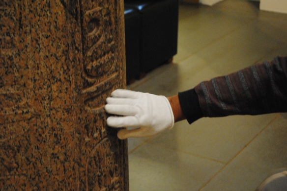 Wearing a white glove, Charles Tatum touches some of the artwork at the MFA's Feeling for Form Access Program.