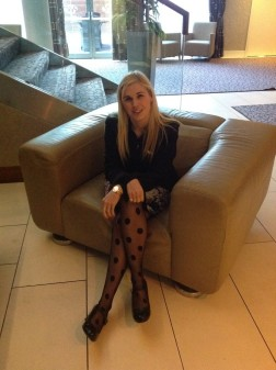 Sinead Kane sitting in a large chair, posing for a photo