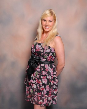 Sinead Kane wearing a floral dress, posing for a photo