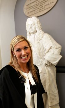 Sinead Kane standing in front of a statue at her graduation as a solicitor in July 2009