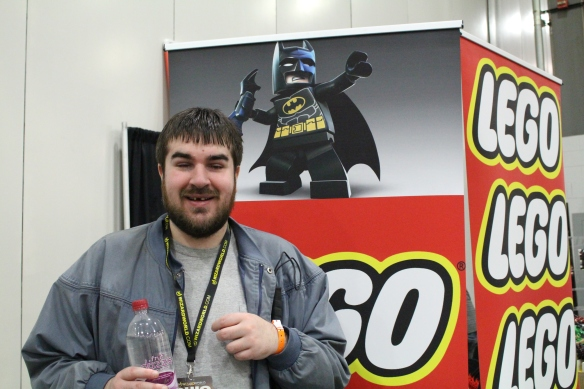 Brandon posing in front of a Lego Batman booth at Ohio Comic Con 2014