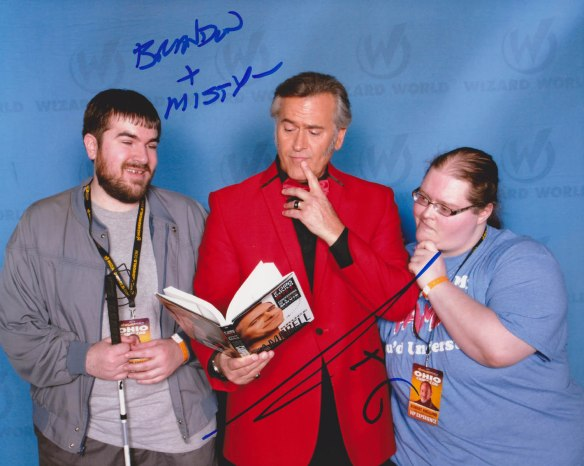 Brandon and his fiance Misty pose with actor Bruce Campbell in an autographed photo