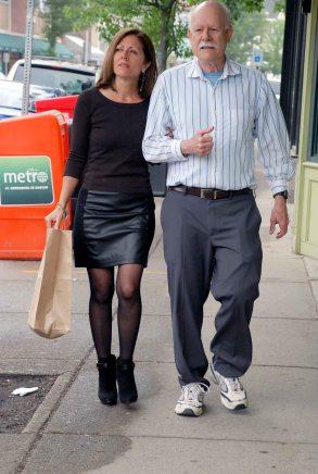Nina walking on a sidewalk with a volunteer