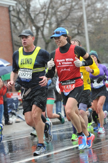 Vincent Hau guiding Richard Hunter as they run the Boston Marathon