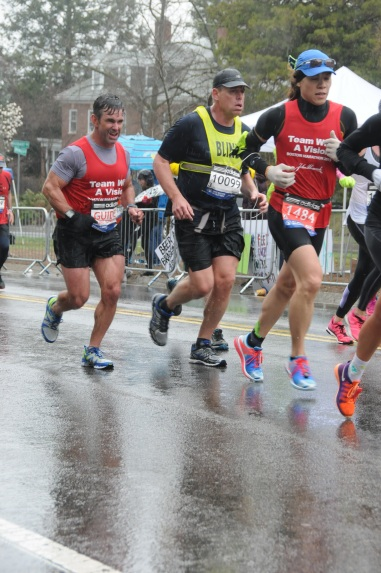 Vincent, Richard, and Dan running in the rain in the Boston Marathon