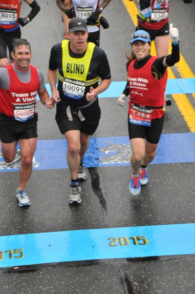 Vincent Hau, Richard, Hunter, and Dan Streetman crossing the Boston Marathon finish line