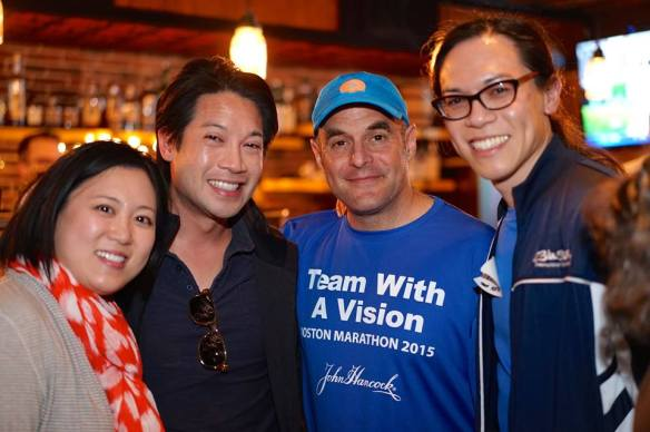 Vincent Hau and family meet NPR host and fellow sighted guide Peter Sagal at an event during Boston Marathon weekend