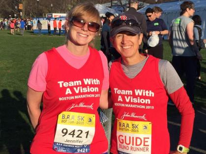 Jen Buchanan and her sighted guide Dr. Jen Salvo pose after racing in the B.A.A. 5K 2015