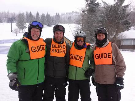 Kyle and his team of skiing guides from Vermont Adaptive Ski & Sports