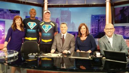David Kuhn posing with the morning anchors of WGN TV in Chicago