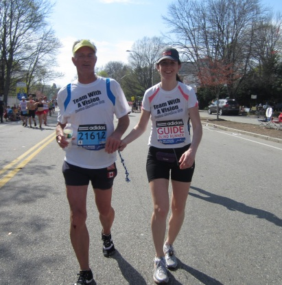 David Kuhn running with MABVI's Andrea Croak as part of Team With A Vision at the Boston Marathon