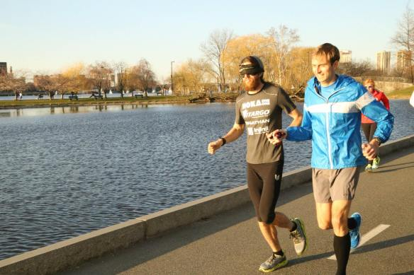 Mike Wardian running blindfolded with Chad Carr guiding