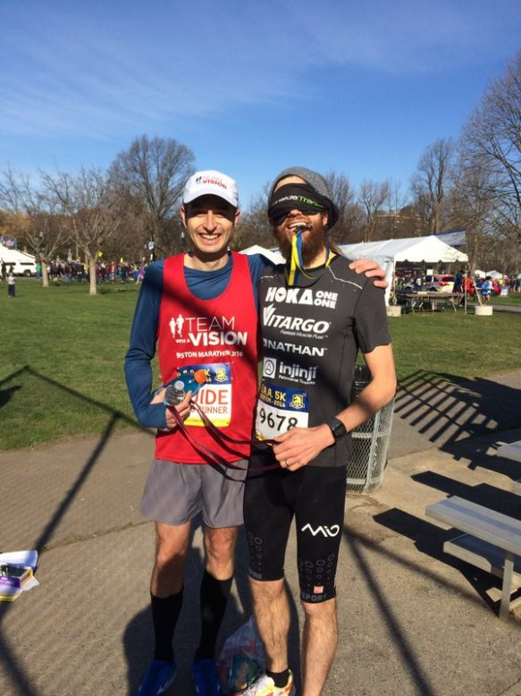 Mike Wardian and Chad Carr posing after the Blindfold Challenge at the BAA 5k
