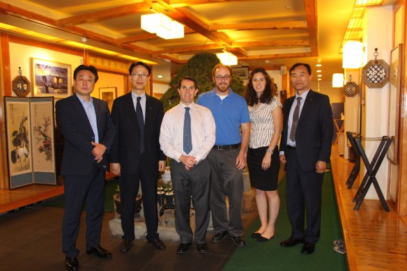Kyle and Andrea pose for a photo at dinner with their fellow presenters and 3 representatives from K-Sports Foundation