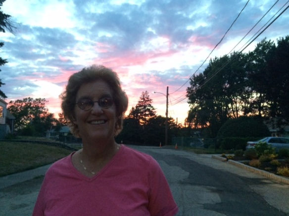 Cindy Wnetz outside with a sunset behind her